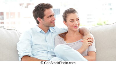 Couple relaxing on the couch and smiling