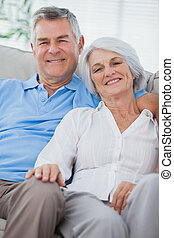 Couple relaxing together on a couch