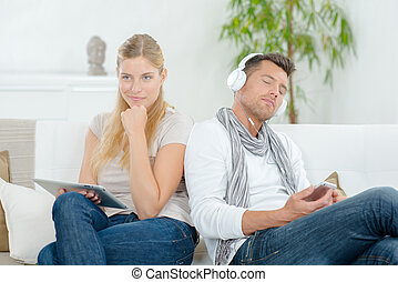 Couple relaxing with technology