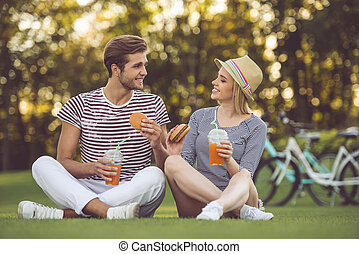 Couple resting in park