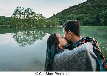 Couple resting on lake