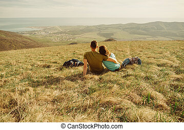 Couple resting on meadow