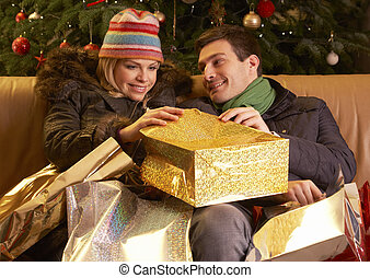 Couple Returning After Christmas Shopping Trip