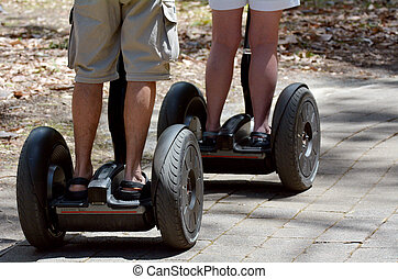 Couple ride on Segway outdoor. concept photo with copy space