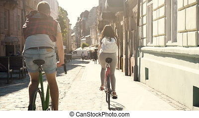 Couple Rides along City Street