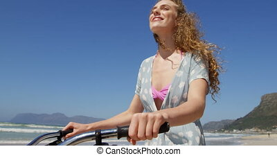 Couple riding bicycle at beach on a sunny day 4k