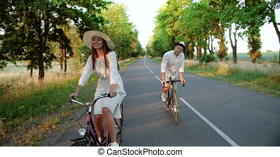 Couple Riding Bicycles on Countryside Road