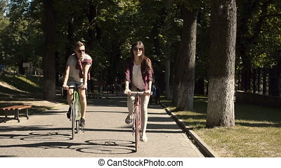 Couple Riding Bikes on Alley