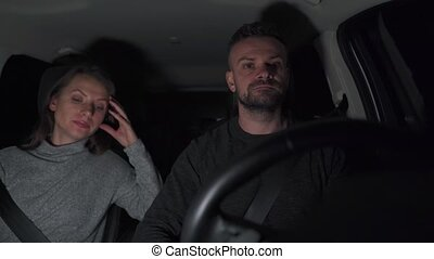 Couple riding in a car is upset because they are stopped by ...