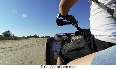 Couple riding quad bike