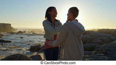 Couple romancing on the rocky shore 4k - Couple romancing on...
