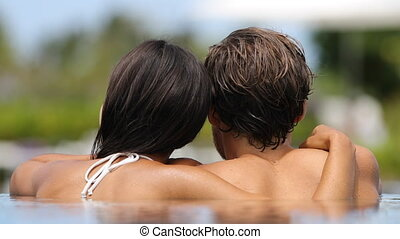 Couple romantic relaxing together in infinity swimming pool