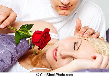couple rose male waking female