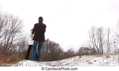Couple rotating on first snow.