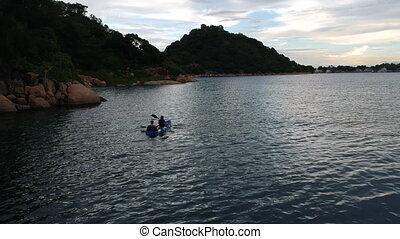 Couple Rowing in Canoe on Lake Malawi - Couple rowing canoe ...
