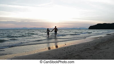 Couple Run From Sea Water Holding Hands Happy Man And Woman...
