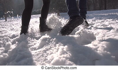 Couple Runing in Snow Park