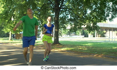 Couple runners celebrating after finishing workout