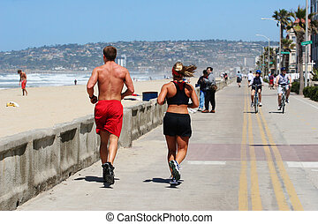 Couple running along the beach