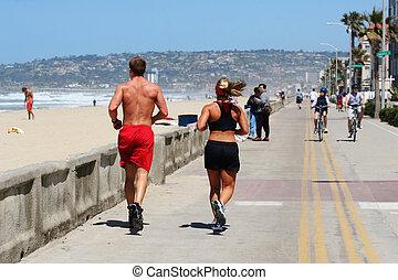 Couple running along the beach