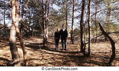 Couple running among trees