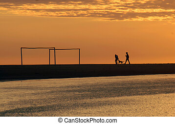 couple running at dawn on the beach