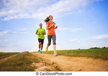Couple running at sunset
