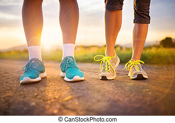 Couple running feet closeup