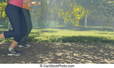 Couple running in a forest close up