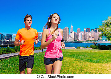 Couple running in New York photo mount in pink and orange...