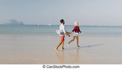 Couple Running On Beach Holding Hands Young Happy Tourists In Love On Vacation