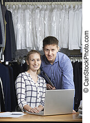 Couple Running On Line Fashion Business