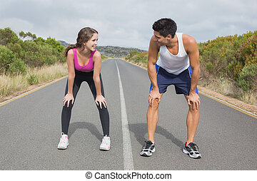 Couple running on the open road together