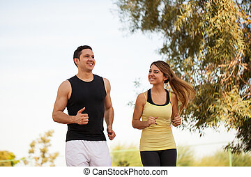 Couple running together and having fun