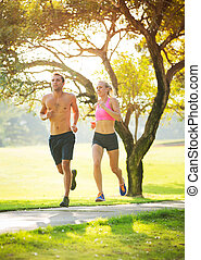 Couple running together in the park