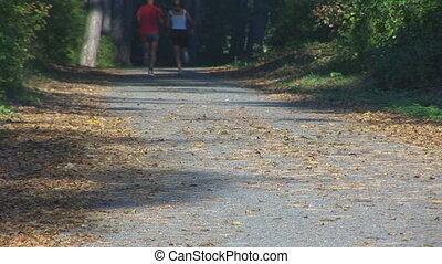 couple running up road, legs part II