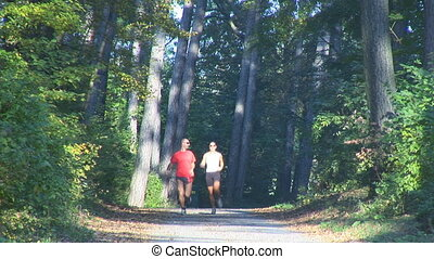 couple running up road, upper body