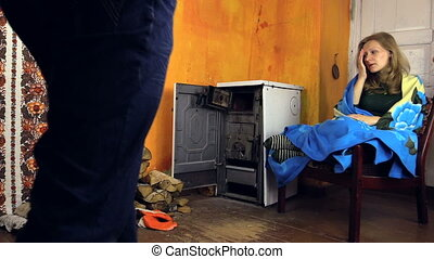 couple rural stove room - man bring his ill wife tea and...