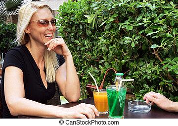 Couple sat drinking on terrace