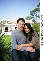 Couple sat on garden decking