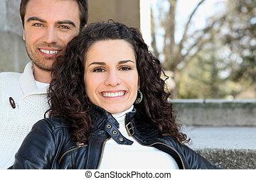 Couple sat on terrace