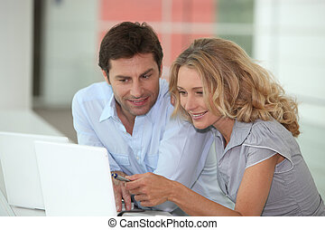 Couple sat with laptop