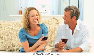 Couple savouring a red wine