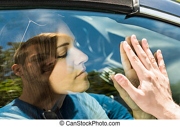 Couple Saying Goodbye Before Car Travel
