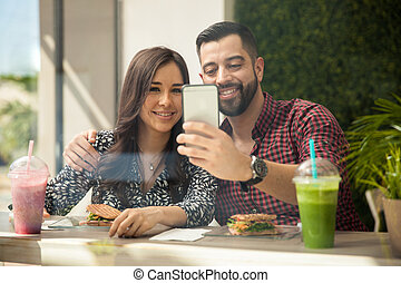 Couple selfie during lunch