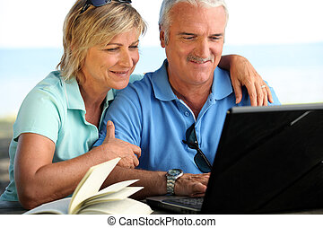 Couple sending e-mail