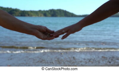 Couple separating their hands, parting, crisis in relations, divorce concept, love story ending, family break-up