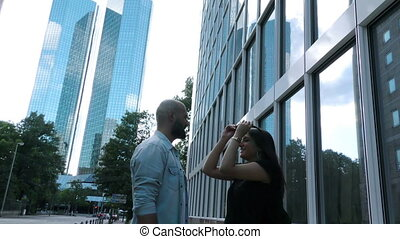 Couple shaking hands in city