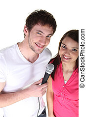 Couple sharing a microphone