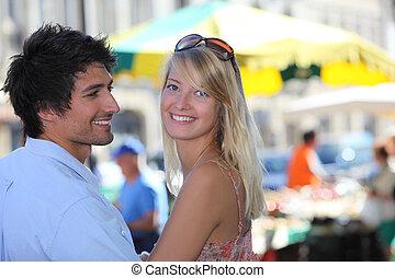 Couple shopping at market
